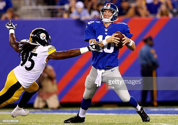 Quarterback Eli Manning of the New York Giants is sacked by outside linebacker Jarvis Jones of the Pittsburgh Steelers during a preseason game at...