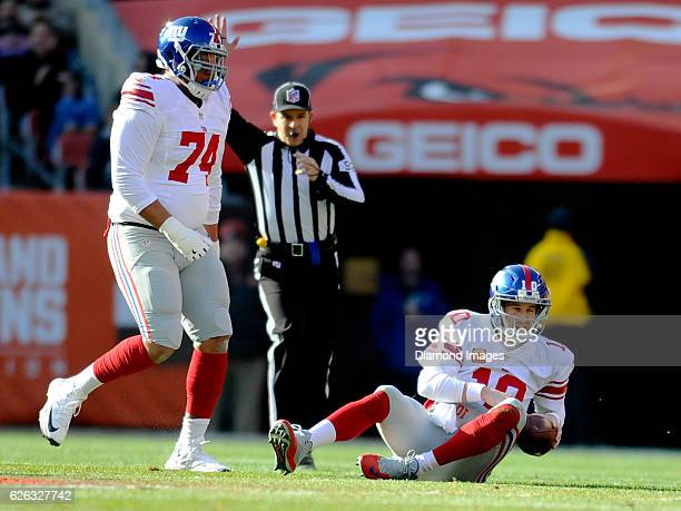 Quarterback Eli Manning of the New York Giants lays on the field after being sacked during a game against the Cleveland Browns on November 27, 2016...