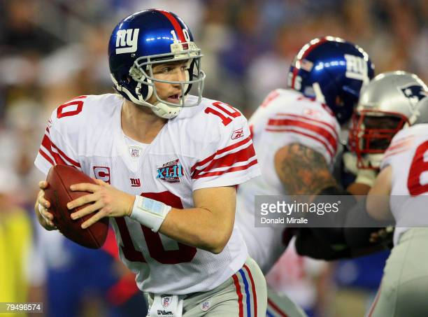 Quarterback Eli Manning of the New York Giants looks to pass the ball against the New England Patriots in Super Bowl XLII on February 3 2008 at the...