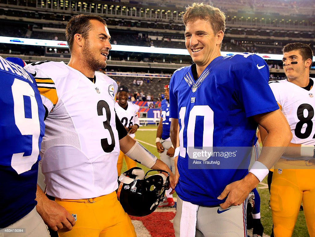 Quarterback Eli Manning #10 of the New York Giants meets with quarterback Landry Jones #3 of the Pittsburgh Steelers following a preseason game at MetLife Stadium on August 9, 2014 in East Rutherford, New Jersey.