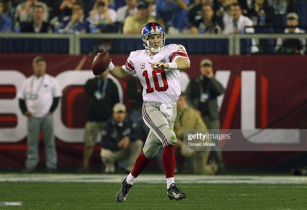 Quarterback Eli Manning #10 of the New York Giants passes against the New England Patriots during Super Bowl XLII on February 3, 2008 at the University of Phoenix Stadium in Glendale, Arizona.