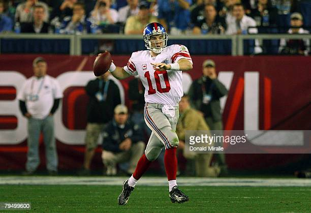 Quarterback Eli Manning of the New York Giants passes against the New England Patriots during Super Bowl XLII on February 3, 2008 at the University...