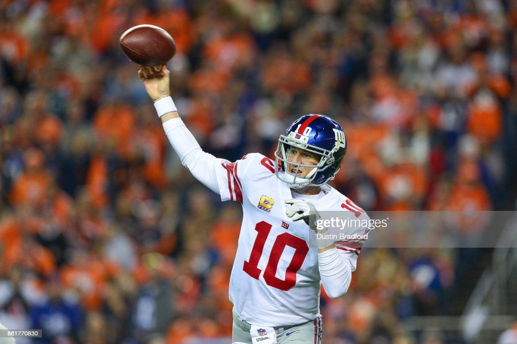 Quarterback Eli Manning #10 of the New York Giants passes against the Denver Broncos in the second quarter of a game at Sports Authority Field at Mile High on October 15, 2017 in Denver, Colorado.