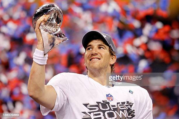 Quarterback Eli Manning of the New York Giants poses with the Vince Lombardi Trophy after the Giants defeated the Patriots by a score of 21-17 in...