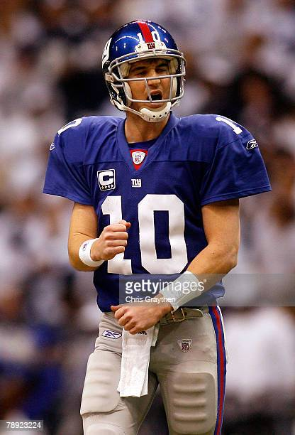 Quarterback Eli Manning of the New York Giants reacts to a missed catch on a third down play during the NFC Divisional Playoff game against the...