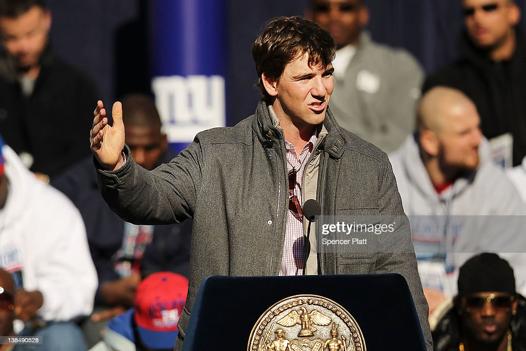 Quarterback Eli Manning of the New York Giants speaks on stage as the team is honored at City Hall Plaza following a ticker-tape parade in Manhattan for the second time in four years after winning the Super Bowl against the New England Patriots on February 7, 2012 in New York City. The Giants beat the Patriots 21-17 at Lucas Oil Stadium in Indianapolis on February 5. The New York parade started at Battery Place and continued through the financial district, an area known as the 'Canyon of Heroes,' to be followed by a rally at their home MetLife Stadium in East Rutherford, New Jersey.