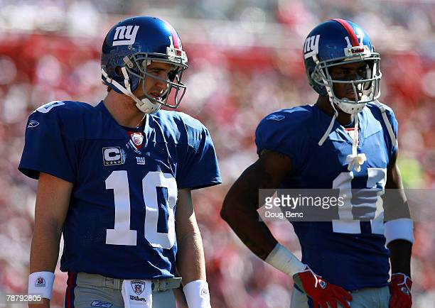 Quarterback Eli Manning of the New York Giants stands with Plaxico Burress before the start of the the first quarter of the NFC Wild Card game...