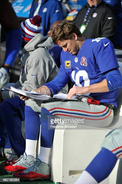 Quarterback Eli Manning of the New York Giants studies during the second half of a game against the Tennessee Titans at LP Field on December 7 2014...