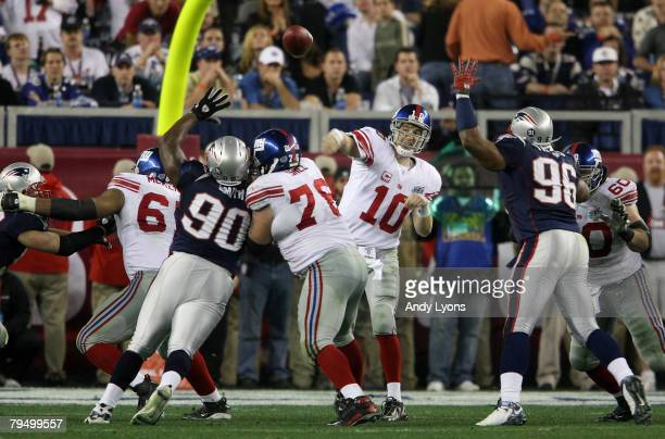 Quarterback Eli Manning of the New York Giants throws the ball during Super Bowl XLII against the New England Patriots on February 3, 2008 at the...