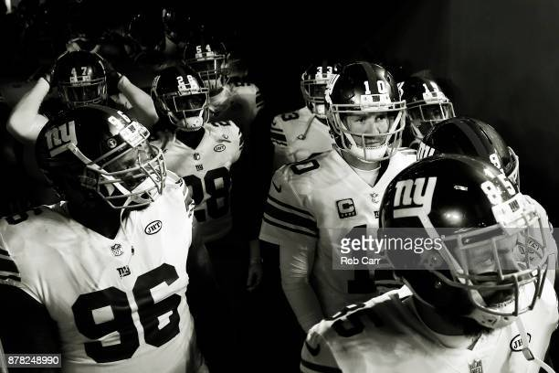 Quarterback Eli Manning of the New York Giants waits to take the field before the start of their game against the Washington Redskins at FedExField...