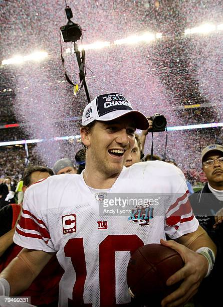 Quarterback Eli Manning of the New York Giants walks off the field after the Giants defeated the New England Patriots 17-14 during Super Bowl XLII on...