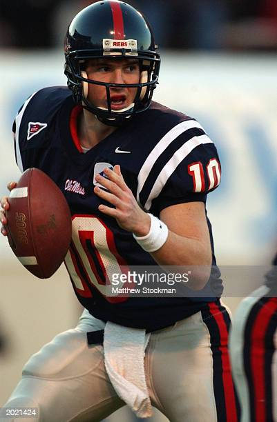 Quarterback Eli Manning of the University of Mississippi Ole Miss Rebels looks to pass during the MainStay Independence Bowl against the University...