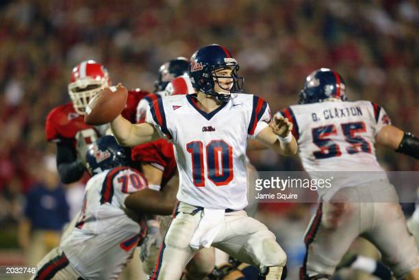 Quarterback Eli Manning of the University of Mississippi Rebels attempts to pass the ball during the SEC game against the University of Georgia...