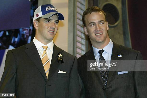 Quarterback Eli Manning stands next to his older brother QB Peyton Manning of the Indianapolis Colts after Eli was selected first overall by the San...
