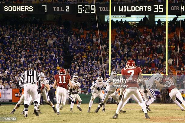 Quarterback Ell Roberson of the Kansas State Wildcats drops back against the Oklahoma Sooners with the final score already on the board in the fourth...