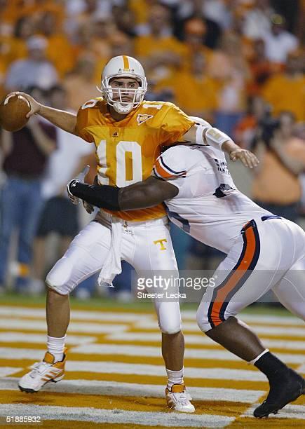 Quarterback Erik Ainge of the Tennessee Volunteers passes under pressure against the Auburn Tigers at Neyland Stadium on October 2 2004 in Knoxville...