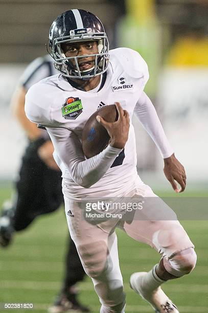 Quarterback Favian Upshaw of the Georgia Southern Eagles carries the ball downfield for a touchdown during their game against the Bowling Green...