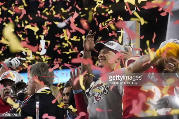 Quarterback for the Kansas City Chiefs Patrick Mahomes and teammates celebrate on the podium after winning Super Bowl LIV against the San Francisco...