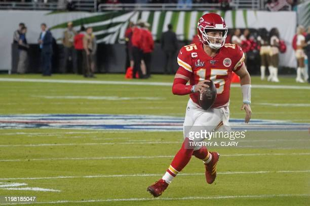 Quarterback for the Kansas City Chiefs Patrick Mahomes carries the ball during Super Bowl LIV between the Kansas City Chiefs and the San Francisco...
