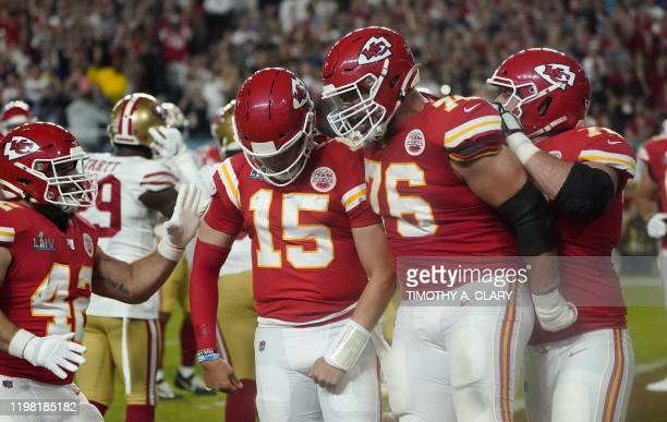 Quarterback for the Kansas City Chiefs Patrick Mahomes celebrates his touchdown with Laurent DuvernayTardif during Super Bowl LIV between the Kansas...