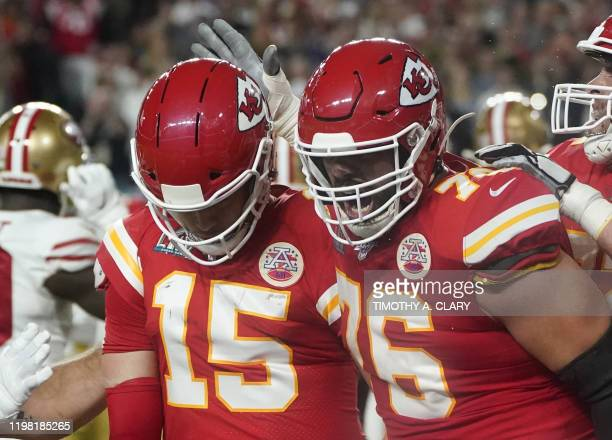 Quarterback for the Kansas City Chiefs Patrick Mahomes celebrates his touchdown with Guard for the Kansas City Chiefs Laurent DuvernayTardif during...