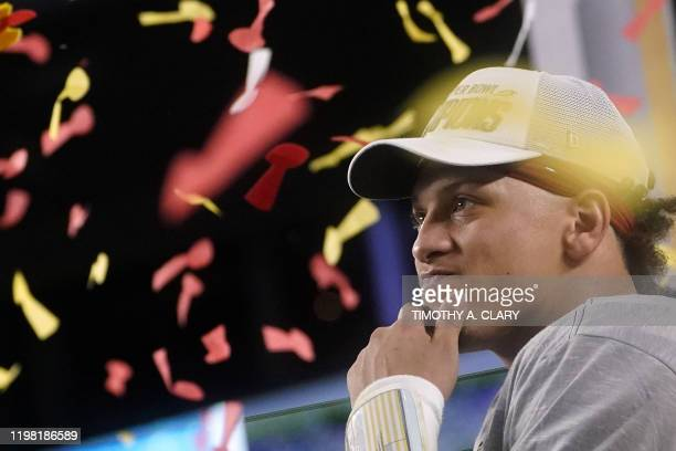Quarterback for the Kansas City Chiefs Patrick Mahomes celebrates on the podium after winning Super Bowl LIV against the San Francisco 49ers at Hard...