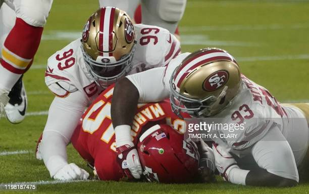 Quarterback for the Kansas City Chiefs Patrick Mahomes gets sacked by Defensive tackle for the San Francisco 49ers DeForest Buckner and Defensive...