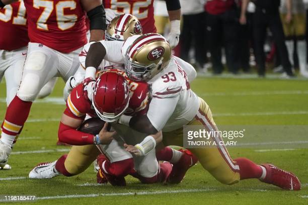 Quarterback for the Kansas City Chiefs Patrick Mahomes is tackled by Defensive Tackle for the San Francisco 49ers Earl Mitchell during Super Bowl LIV...