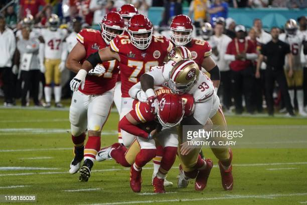 Quarterback for the Kansas City Chiefs Patrick Mahomes is tackled during Super Bowl LIV between the Kansas City Chiefs and the San Francisco 49ers at...