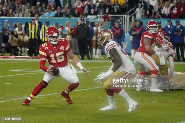 Quarterback for the Kansas City Chiefs Patrick Mahomes looks to throw the ball before running to score a touchdown during Super Bowl LIV between the...