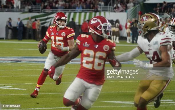 Quarterback for the Kansas City Chiefs Patrick Mahomes looks to throw the ball during Super Bowl LIV between the Kansas City Chiefs and the San...