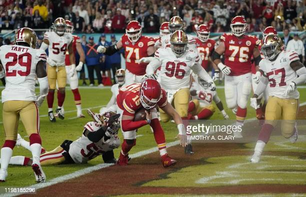 Quarterback for the Kansas City Chiefs Patrick Mahomes runs the ball to score a touchdown during Super Bowl LIV between the Kansas City Chiefs and...