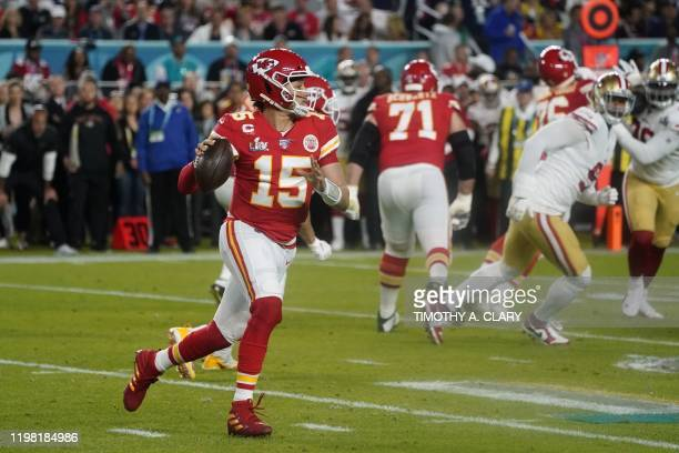 Quarterback for the Kansas City Chiefs Patrick Mahomes runs with the ball during Super Bowl LIV between the Kansas City Chiefs and the San Francisco...