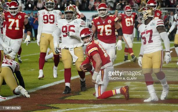 Quarterback for the Kansas City Chiefs Patrick Mahomes scores a touchdown during Super Bowl LIV between the Kansas City Chiefs and the San Francisco...