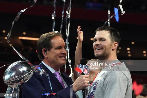 TOPSHOT Quarterback for the New England Patriots Tom Brady celebrates after winning Super Bowl LIII against the Los Angeles Rams at MercedesBenz...