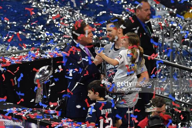 Quarterback for the New England Patriots Tom Brady stands with his children near the trophy as he celebrates after winning Super Bowl LIII against...