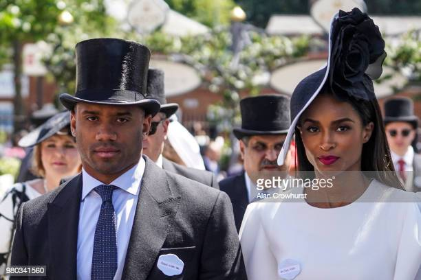 Quarterback for the Seattle Seahawks Russell Wilson arrives with Ciara on day 3 of Royal Ascot at Ascot Racecourse on June 21 2018 in Ascot England