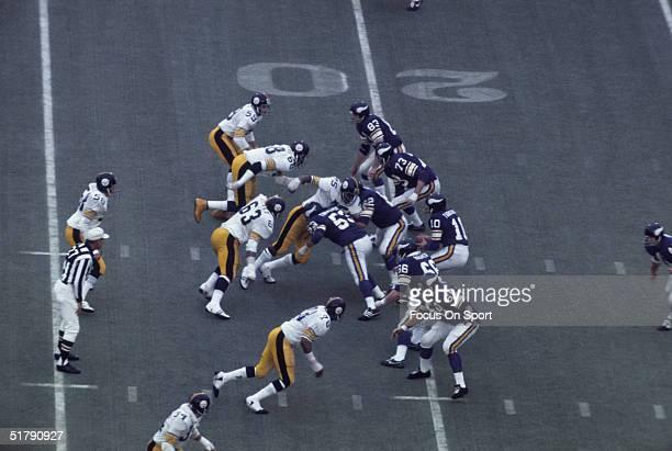 Quarterback Fran Tarkenton of the Minnesota Vikings drops back to pass during Super Bowl IX against the Pittsburgh Steelers at Tulane Stadium on...