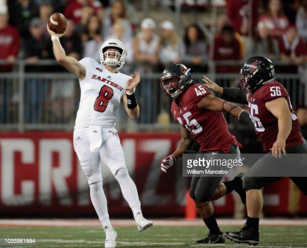 Quarterback Gage Gubrud of the Eastern Washington Eagles throws a pass against Logan Tago and Taylor Comfort of the Washington State Cougars in the...