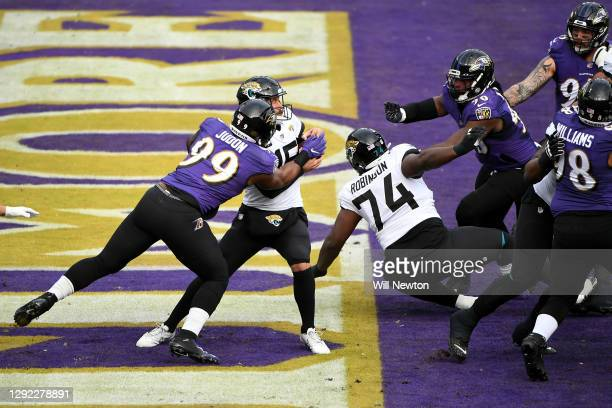 Quarterback Gardner Minshew II of the Jacksonville Jaguars is sacked by linebacker Matthew Judon of the Baltimore Ravens in the end zone for a safety...