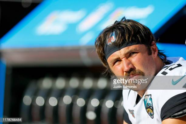 Quarterback Gardner Minshew of the Jacksonville Jaguars looks on from the bench against the Denver Broncos during the third quarter at Empower Field...