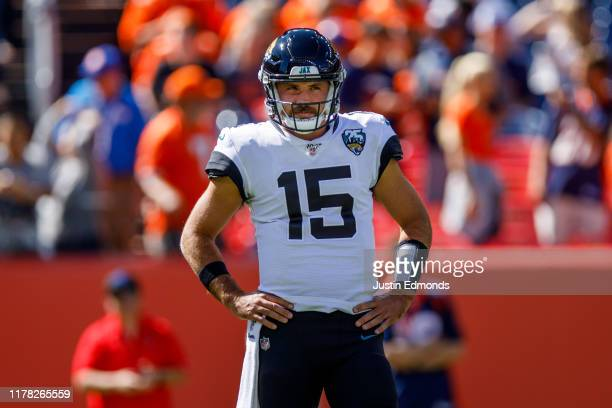 Quarterback Gardner Minshew of the Jacksonville Jaguars looks on against the Denver Broncos before the game at Empower Field at Mile High on...
