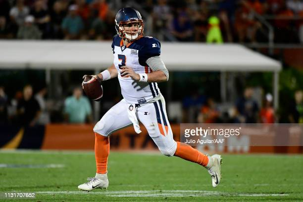 Quarterback Garrett Gilbert of the Orlando Apollos scrambles before throwing a touchdown pass against the Memphis Express during the third quarter of...