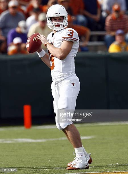 Quarterback Garrett Gilbert of the Texas Longhorns drops back to pass during the second half against the Baylor Bears on November 14 2009 at Floyd...
