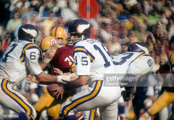Quarterback Gary Cuozzo of the Minnesota Vikings drops back to pass against the Washington Redskins during an NFL football game at RFK Stadium...
