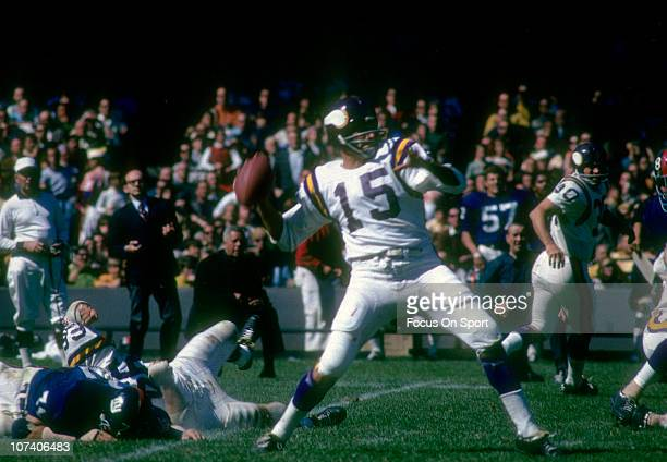 Quarterback Gary Cuozzo of the Minnesota Vikings throws a pass against the New York Giants during an NFL football game at Yankee Stadium September 21...