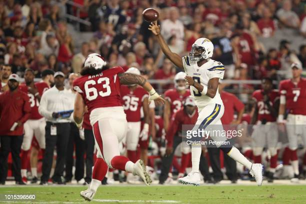Quarterback Geno Smith of the Los Angeles Chargers throws a pass over defensive tackle Peli Anau of the Arizona Cardinals during the preseason NFL...
