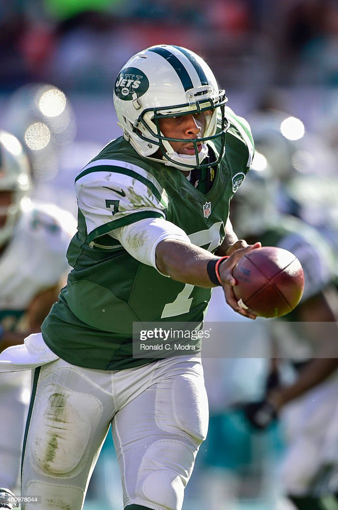 Quarterback Geno Smith #7 of the New York Jets hanks off during a game against the Miami Dolphins at Sun Life Stadium on December 28, 2014 in Miami Gardens, Florida.