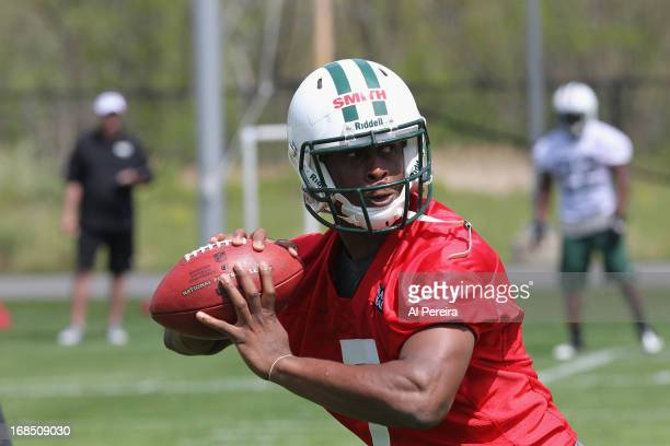 Quarterback Geno Smith of the New York Jets passes the ball during New York Jets Rookie Minicamp on May 10 2013 at the Atlantic Health Jets Training...