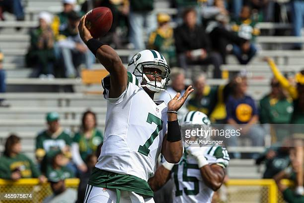 Quarterback Geno Smith of the New York Jets throws the football during warmups prior to the NFL game against the Green Bay Packers on September 14...